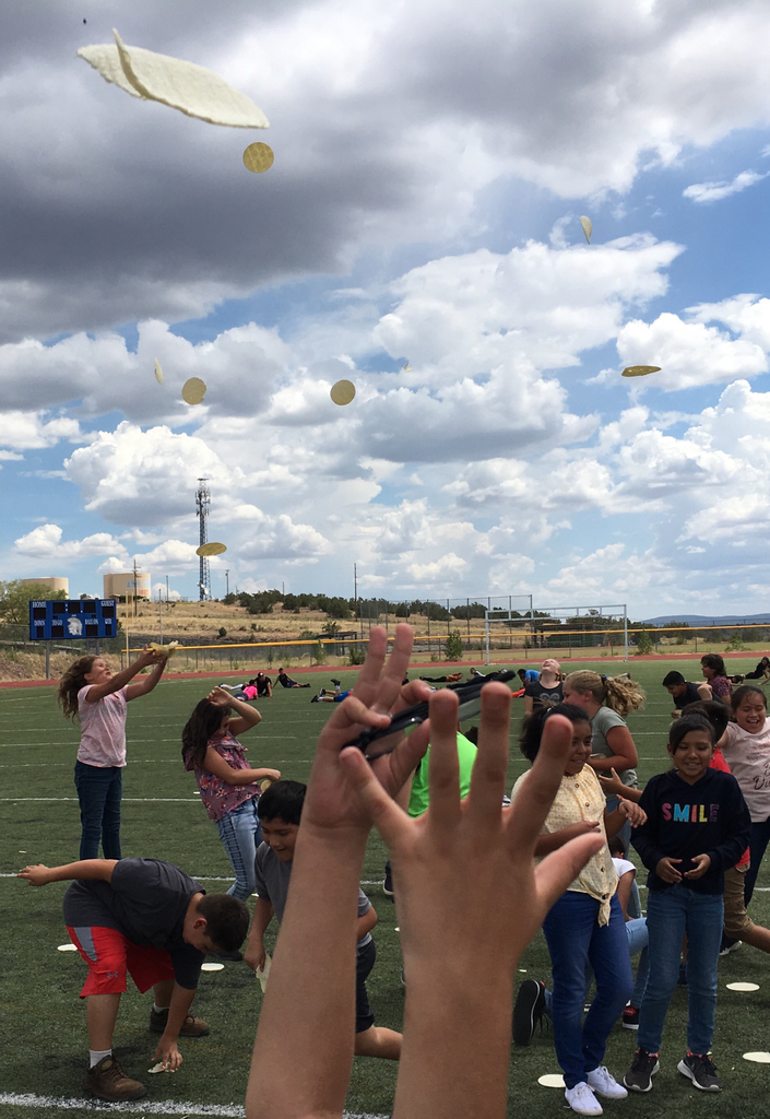 3-5 students throwing tortillas