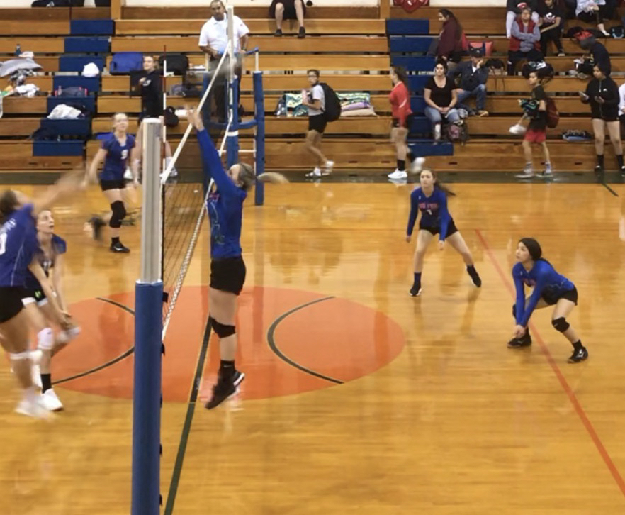 Evelyn going for a block, Paola and Emily ready for the hit