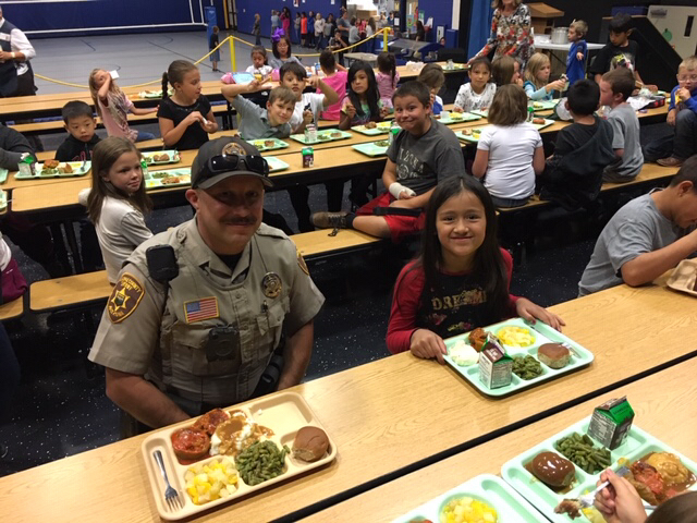 Law Enforcement eating lunch with elementary students